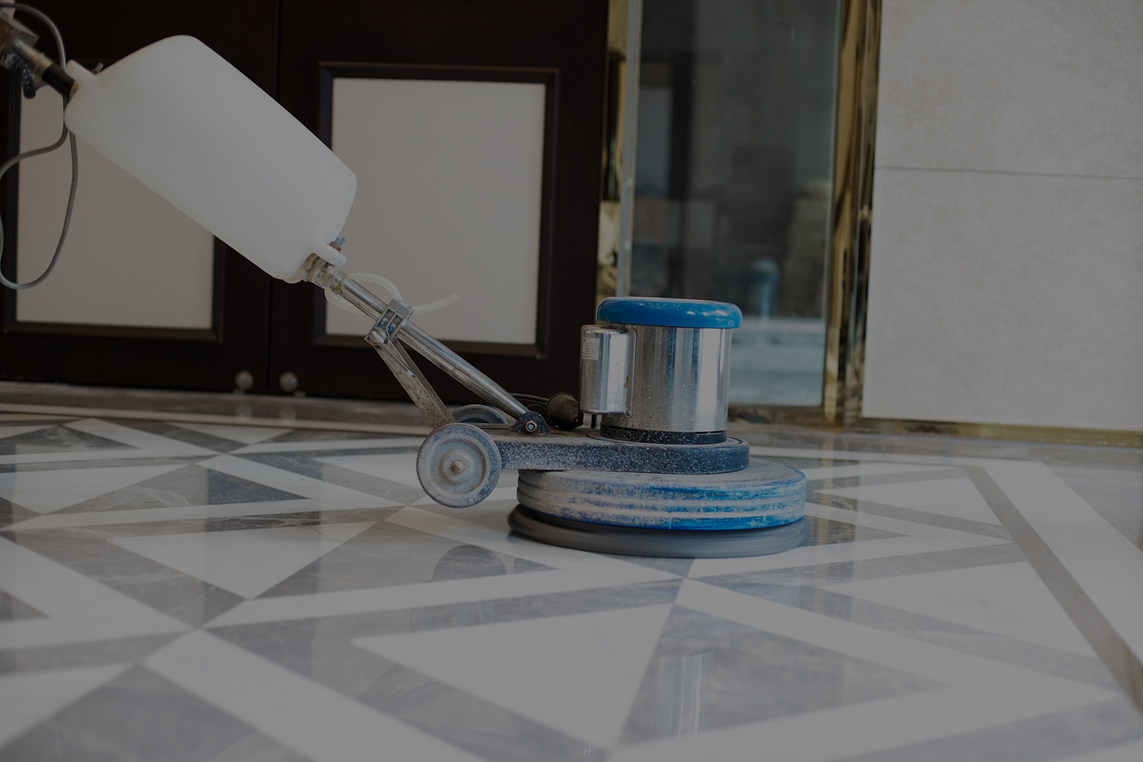 working polisher on marble floor
